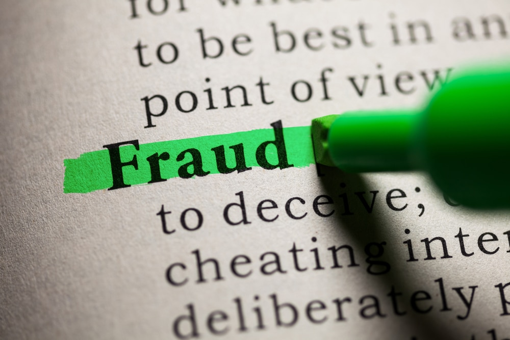 Dictionary definition of fraud highlighted