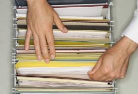 Hands Filing Paperwork